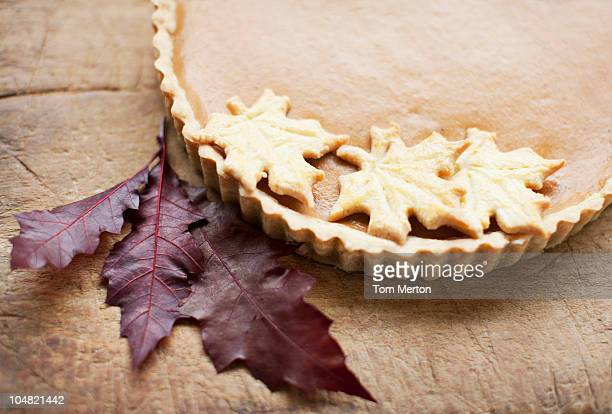 Maple leaf cookies on pumpkin pie