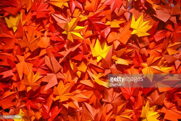 maple leaf origami texture - origami stock pictures, royalty-free photos & images