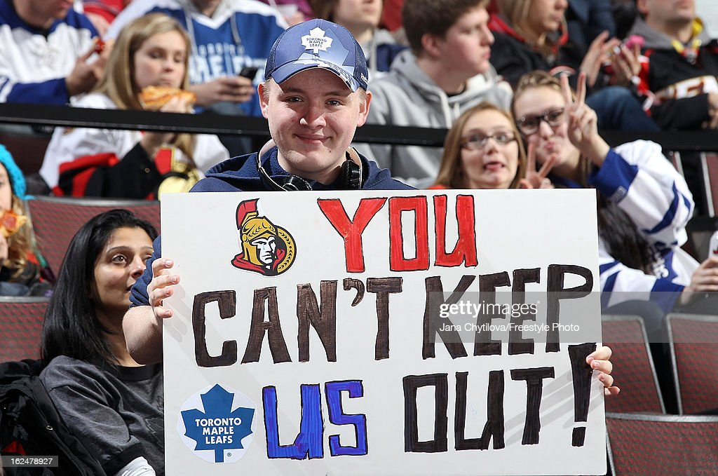 A Maple Leafs fan holds up a sign following a letter that was sent encouraging Sens season ticket holders not to re-sell their tickets to Leafs fans, during an NHL game between the Ottawa Senators and the Toronto Maple Leafs during an NHL game at Scotiabank Place on February 23, 2013 in Ottawa, Ontario, Canada.