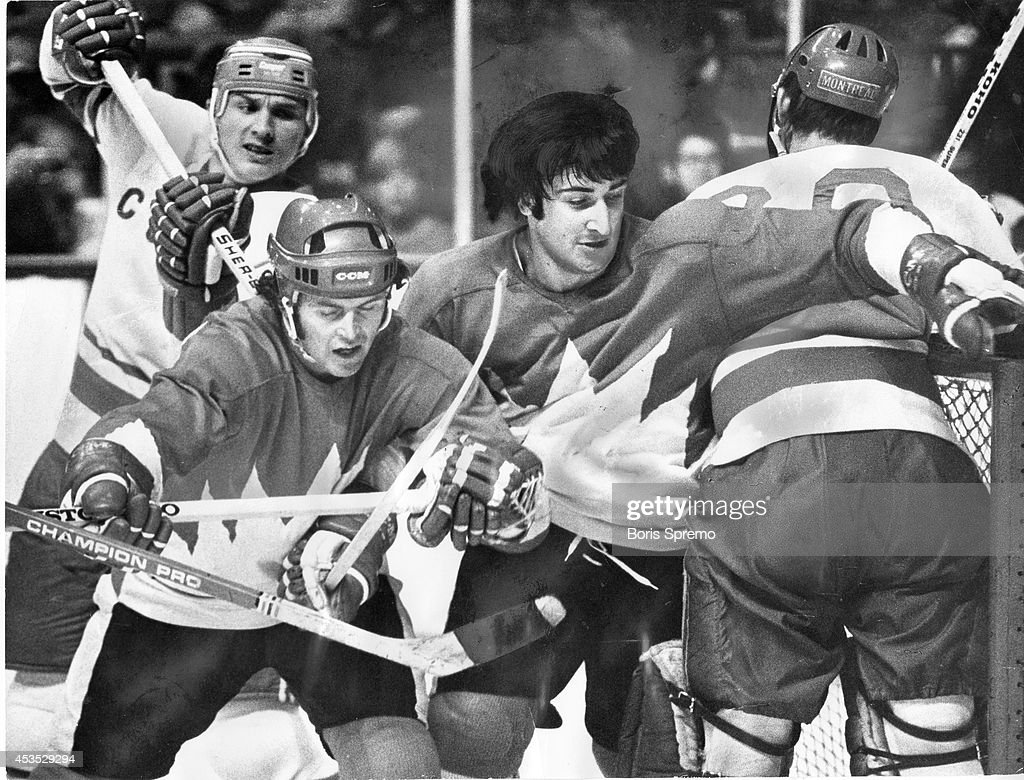 Maple Leafs' Paul Henderson, left foreground, with helmet, and Montreal's Guy Lapointe must've thought they were in woods as they battle in front of Soviet Union goalie Vladislav Tretiak, during Canada's 4-1 win at Gardens last night. There was some tough going as both teams engaged in strong physical game, with considerable amount of chippy infraction which the officials didn't penalize.