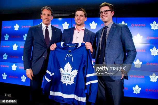 Maple Leafs president Brendan Shanahan, John Tavares and Leafs general manager Kyle Dubas pose for a photo during the announcement. The Toronto Maple...