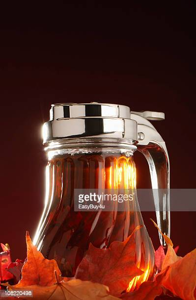 Maple Syrup in Jar with Autumn Leaves
