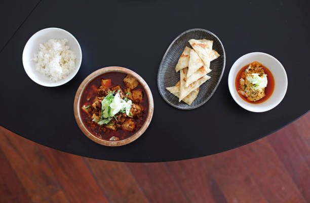 Mapo Tofu and Chinese Hummus are served with steamed rice and baked house flatbread triangles at Tao Yuan.