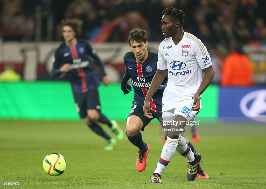 Mapou Yanga-Mbiwa of Lyon and Benjamin Stambouli of PSG (left) in action during the French Ligue 1 match between Olympique Lyonnais (OL) and Paris Saint-Germain (PSG) at Parc Olympique Lyonnais stadium (Parc OL) on February 28, 2016 in Lyon, France.