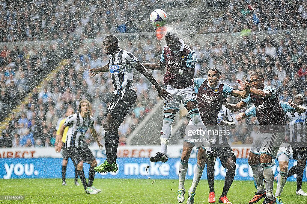 Mapou Yanga-Mbiwa of Newcastle challenges Modibo Maiga of West Ham for a header during the Barclays Premiership Match between Newcastle United and West Ham United at St. James Park on August 24, 2013, in Newcastle upon Tyne, England.