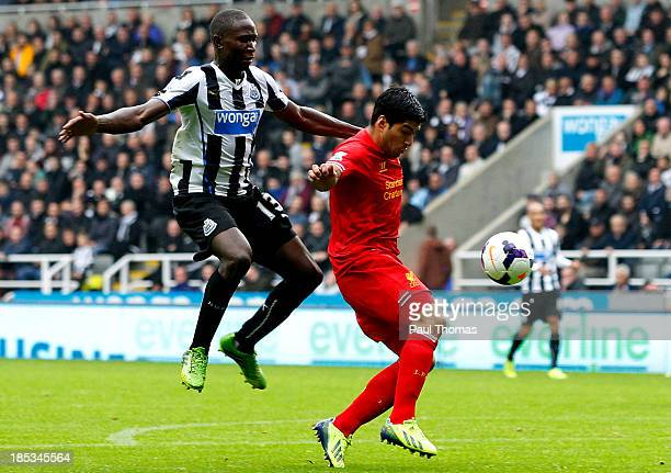 Mapou YangaMbiwa of Newcastle fouls Luis Suarez of Liverpool inside the penalty area before receiving a red card and conceding a penalty during the...