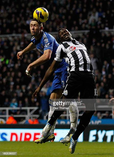 Mapou YangaMbiwa of Newcastle in action with Gary Cahill of Chelsea during the Premier League match between Newcastle United and Chelsea at St James...
