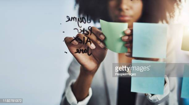 mapping out her brightest ideas - adhesive note stock pictures, royalty-free photos & images