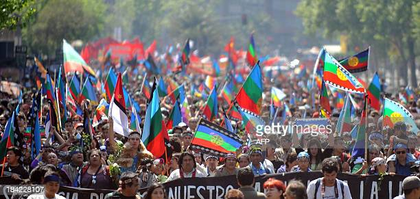 Mapuche indigenous people march during a protest for the commemoration of Columbus Day in downtown Santiago on October 12 2013 AFP PHOTO/Hector...