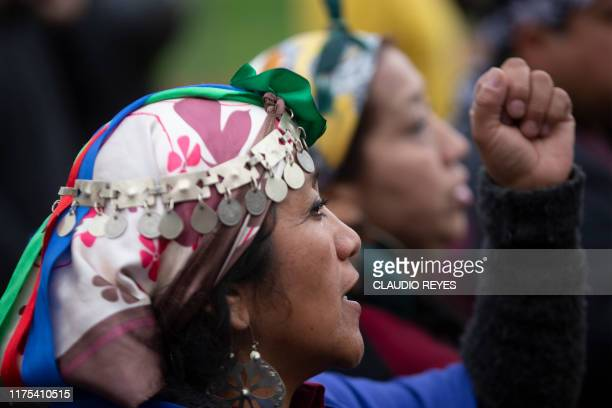 Mapuche indigenous people march in protest in downtown Santiago on October 12 during the commemoration of the Day of the Race