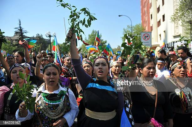 Mapuche indigenous people march in protest in downtown Santiago on October 12 during the commemorations for Columbus Day AFP PHOTO/Hector RETAMAL
