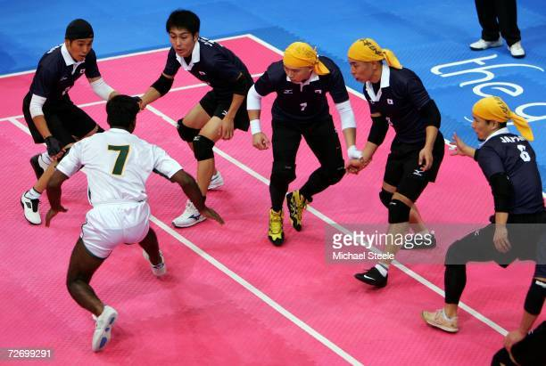Maqsood Ali of Pakistan makes a raid on the Japanese team during the Men's Kabaddi Round Robin match between Pakistan v Japan at the 15th Asian Games...
