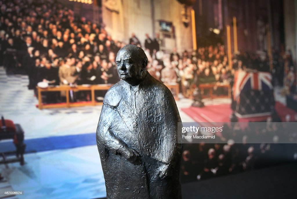 A Maquette of Winston Churchill by Franta Belsky is displayed at Chartwell in front of a large photograph of his funeral on January 23, 2015 in Westerham, England. The 'Death of a Hero' exhibition is opening at Chartwell, home of Britain's wartime leader Winston Churchill, to commemorate the 50th anniversary of his death and state funeral in 1965.
