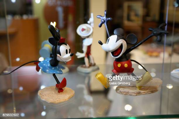 Maquettes of the animated characters Minnie Mouse and Mickey Mouse are displayed during a preview event at the Magical Memories Fine Art Gallery...