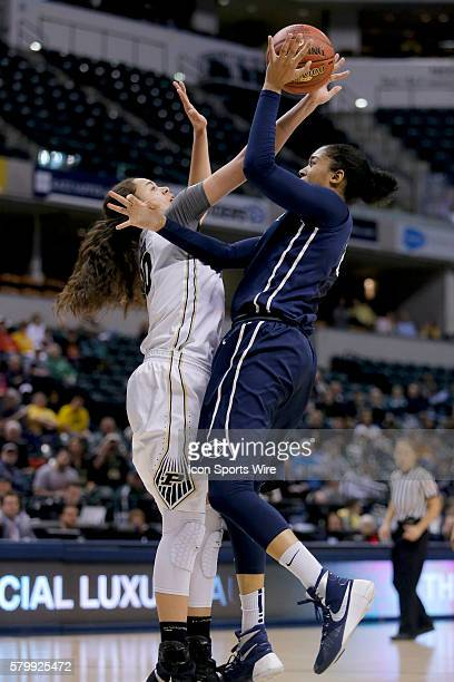 Purdue Boilermakers forward Dominique McBryde blocks the shot of Penn State Nittany Lions guard Brianna Banks during the Women's Big Ten Tournament...