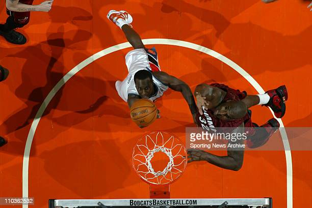 Mar 06 2006 Charlotte NC USA Charlotte Bobcats BREVIN KNIGHT against Miami Heat SHAQUILLE O'NEAL during the Miami Heat against the Charlotte Bobcats...