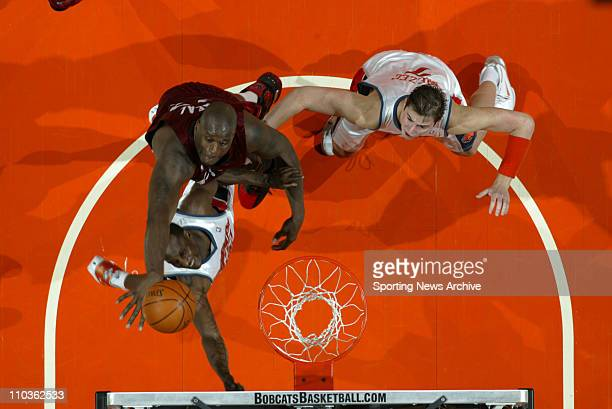 Mar 06 2006 Charlotte NC USA Charlotte Bobcats BREVIN KNIGHT and PRIMOZ BREZEC against Miami Heat SHAQUILLE O'NEAL during the Miami Heat against the...