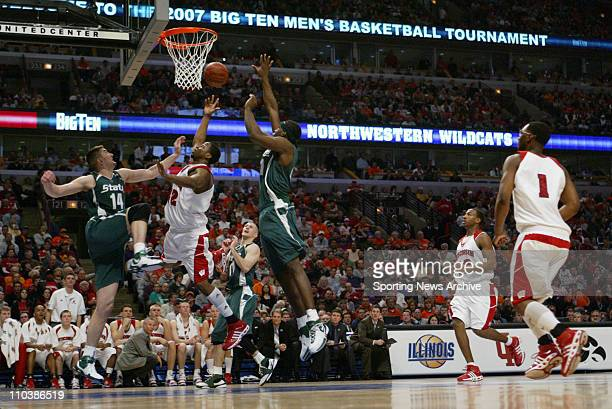Mar 09 2007 Chicago IL USA Wisconsin ALANDO TUCKER against Michigan State GORAN SUTON Marquise Gray during the Big Ten Tournament at the United...