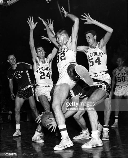 Mar 11, 1958 - Kentucky players DON OGOREK , JOHNNY COX , JOHN CRIGLER fouling JERRY FRIZZELL with the ball, DON MILLS and ADRIAN SMITH in the 1958...