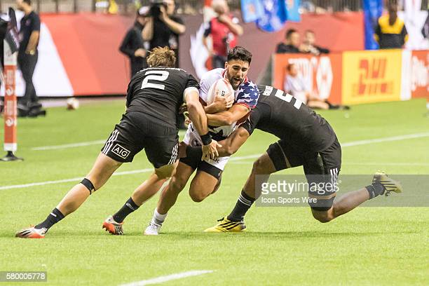 Nate Augspurger of USA tackled by a pair of New Zealanders Tim Mikkelson and Dylan Collier during the Pool match between USA and New Zealand at the...
