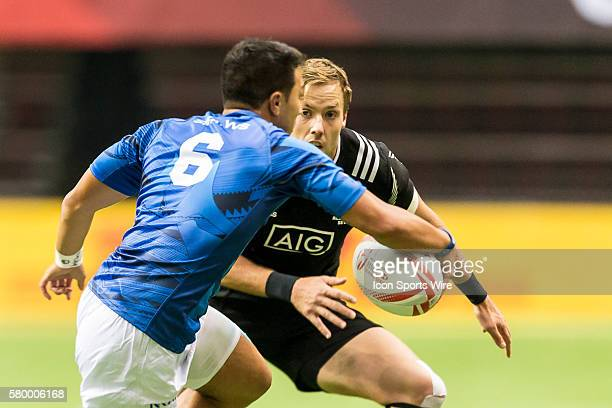 Tim Mikkelson of New Zealand face off with Phoenix HunapoNofoa of Samoa during the Cup Quarter Final match between New Zealand and Samoa at the...