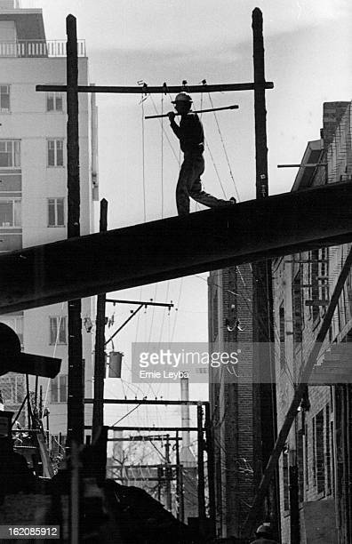 Mar 17 1971; A workman walks across a girder at the construction site of Lincoln Center in the alleyway behind the complex going up at E. 17th Ave....