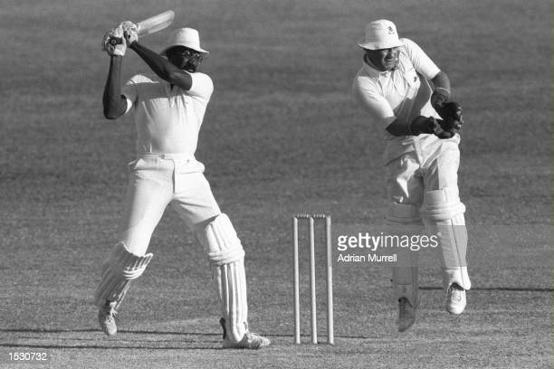 Clive Lloyd of the West Indies hits four during his innings of 100 in the third test against England at Barbados in the West Indies. Mandatory...