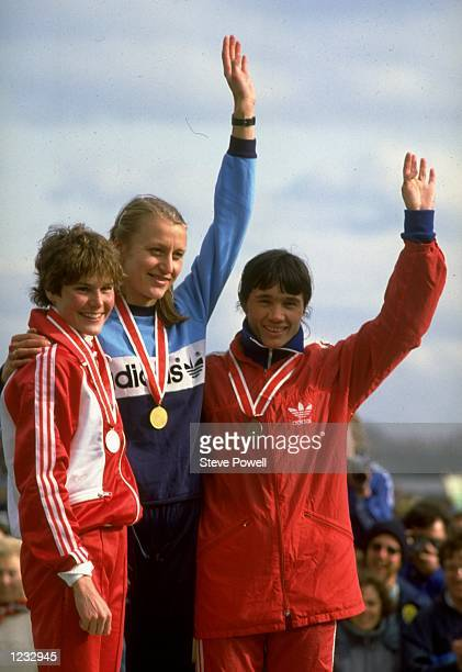 Greta Waitz of Norway waves to the crowd after the Senior Womens race at the IAAF World Cross Country Championships in Gateshead England Waitz won...