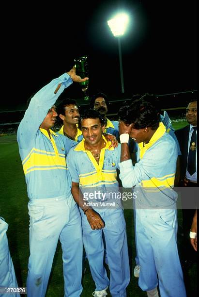 The Indian team celebrate after winning the World Championship match against Pakistan at the Melbourne Cricket Ground in Australia Mandatory Credit...