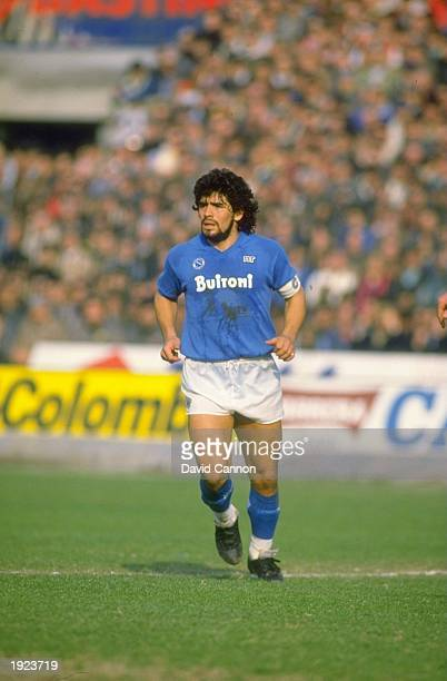 Diego Maradona of Napoli SSC keeps an eye on the ball during an Italian League match against Juventus FC at the Delle Alpi Stadium in Turin Italy The...