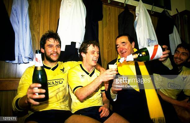 Jeremy Charles and Les Phillips of Oxford United celebrate with Robert Maxwell after their victory in the Milk Cup semifinal second leg against Aston...