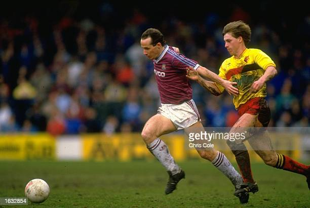 Liam Brady of West Ham United gets away from L Simon of Watford during a Today League Division One match against Watford at Upton Park in London West...