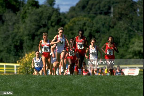 Angela Tooby of Great Britain leads the field during the Womens race at the IAAF World Cross Country Championships in Auckland New Zealand Mandatory...