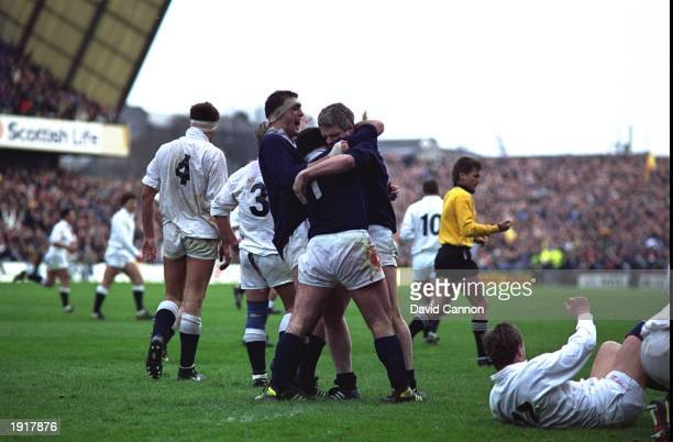 Chris Gray David Sole and Finlay Calder of Scotland celebrate during the 1990 Five Nations Championship match between Scotland and England at...
