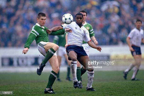 Derek Brazil of the Republic of Ireland takes on Dalian Atkinson of England B during a match in the Republic of Ireland Mandatory Credit Ben...