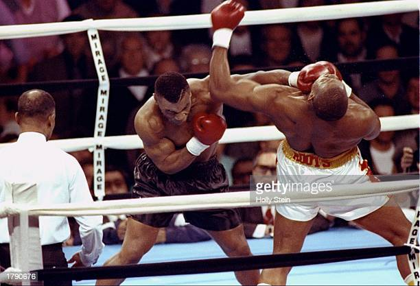 Mike Tyson connects with a punch to the head of Donovan 'Razor' Ruddock during a bout at The Mirage in Las Vegas Nevada Tyson won the bout with a...