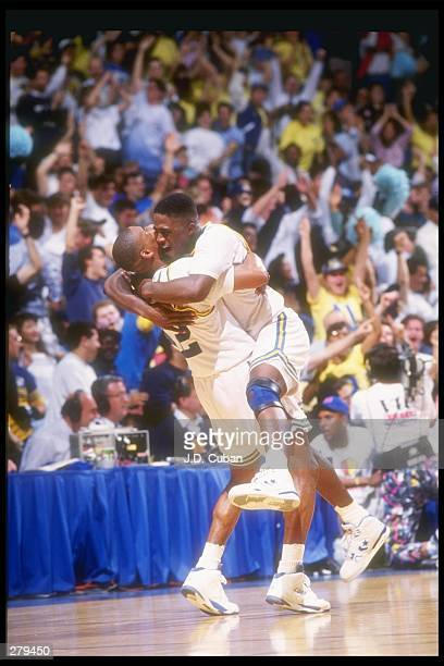 Guard Mitchell Butler of the UCLA Bruins celebrates with teammate Gerald Madkins during a game against the Arizona Wildcats UCLA won the game 8981