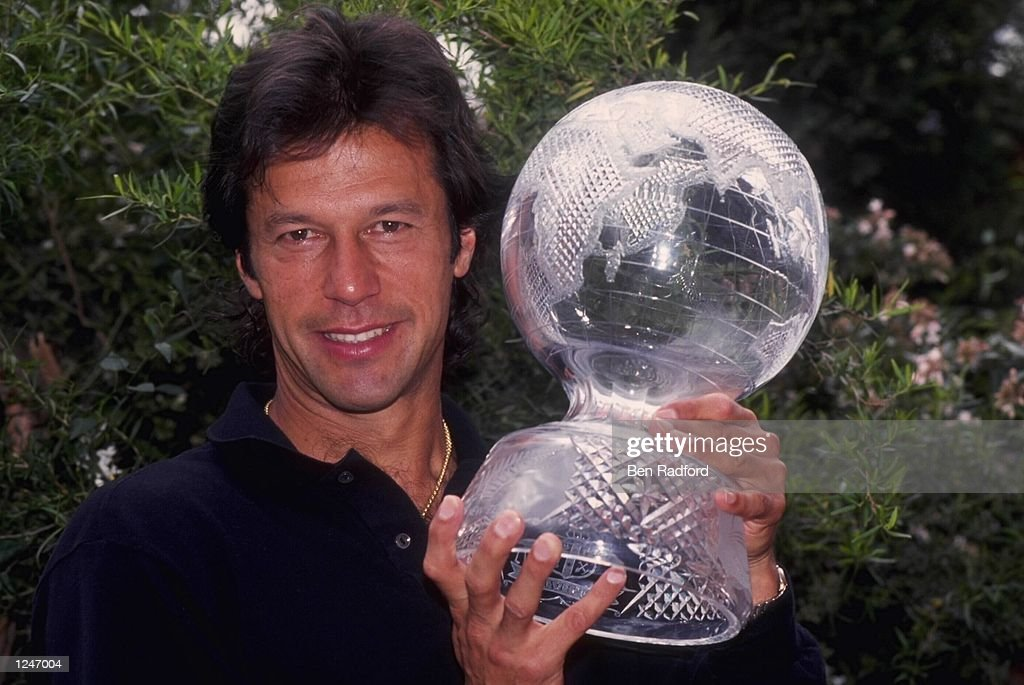 Imran Khan, the captain of Pakistan displays the Cricket World Cup trophy after his country beat England in the final at the MCG in Melbourne.
