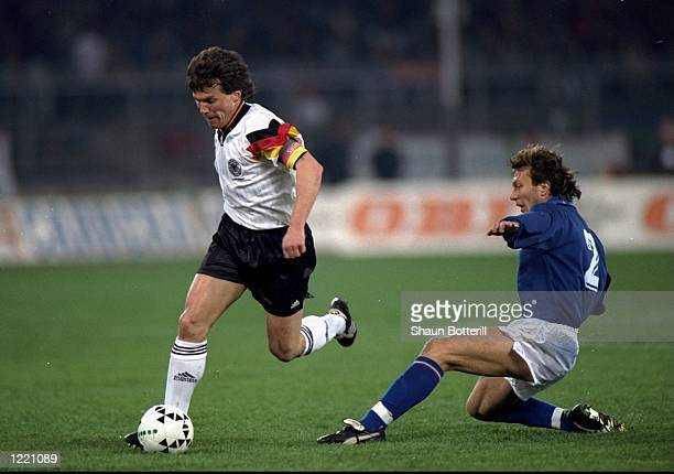 Lothar Matthaus of Germany avoids the challenge of Mannini of Italy during the international friendly match played in Italy Italy won the match 10...