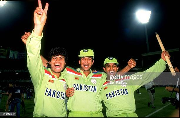 Mahmood Fazal Wasim Akram and Aamir Sohail of Pakistan celebrate their 22 run victory in the World Cup final against England at the Melbourne Cricket...