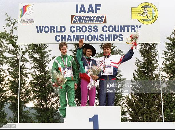 Catherina McKiernan of Ireland winner Albertina Dias of Portugal and Lynn Jennings of the USA on the podium after the World Cross Country...
