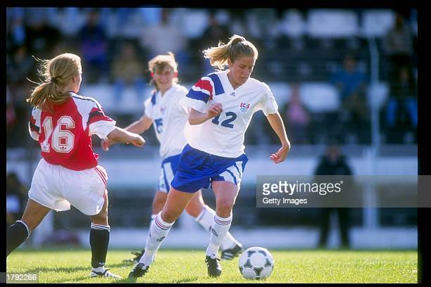 Carin Gabarra of the USA and Dorthe Larsen of Norway run down the field during an Algarve Cup game Mandatory Credit Allsport /Allsport