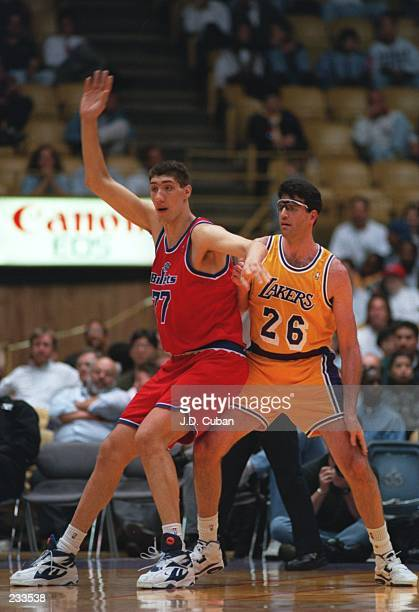 Center Gheorghe Muresan of the Washington Bullets posts up during the Bullets versus Los Angeles Lakers game at the Great Western Forum in Inglewood...