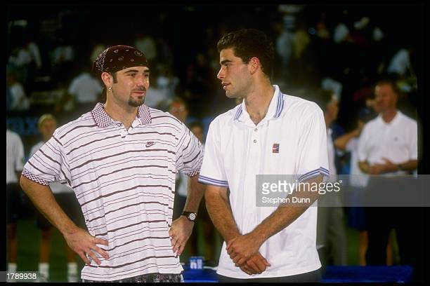 Andre Agassi chats with Pete Sampras during the Newsweek Champions Cup tournament Mandatory Credit Stephen Dunn /Allsport