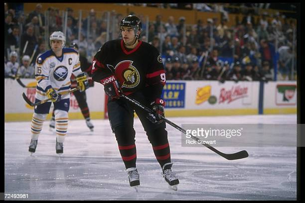 Center Alexandre Daigle of the Ottawa Senators looks on during a game against the Buffalo Sabres at Memorial Auditorium in Buffalo New York The...