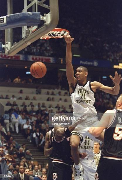 Center Tim Duncan of the Wake Forest Demon Deacons sinks the ball during a game against the Oklahoma State Cowboys Oklahoma State won the game 7166...