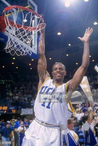 Guard Tyus Edney of the UCLA Bruins celebrates after a game against the Oregon Ducks UCLA won the game 9479