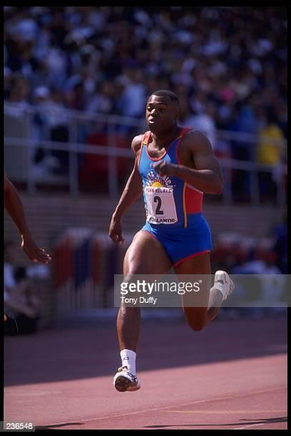 Leroy Burell of the Santa Monica Track Club runs his leg of the men''s 4x100m relay during the Penn Relays Track Meet held in Philadelphia,...