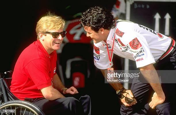 Marlboro Yamaha Boss Wayne Rainey of the USA chats with Daryl Beattie of Australia during the Australian Grand Prix at the Eastern Creek circuit in...