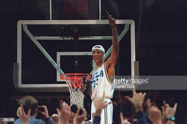 UCLA FORWARD ED O''BANNON CELEBRATES BY CUTTING HIS PART OF THE NET AFTER THE BRUINS 102-96 WIN OVER UCONN IN THE NCAA WEST REGIONAL FINAL AT THE...